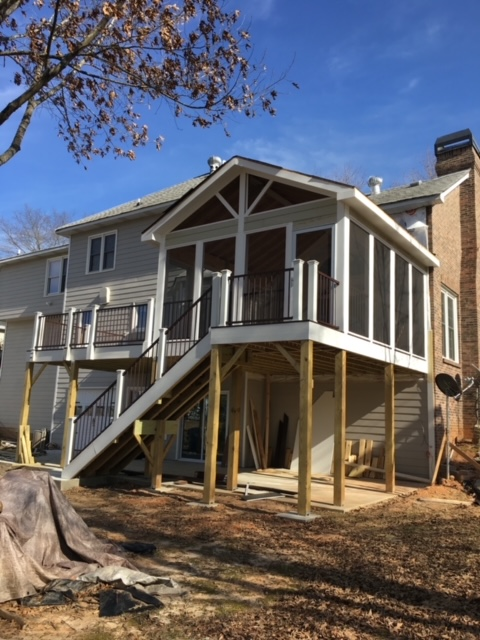 back of home with new deck and screened porch addition