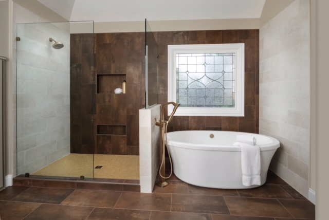 beautiful modern bathroom with glass shower enclosure and free standing bathtub