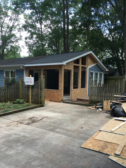 in progress house with sunroom addition