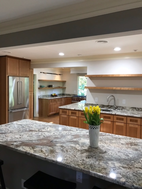 modern kitchen with wood cabinets and stone countertops