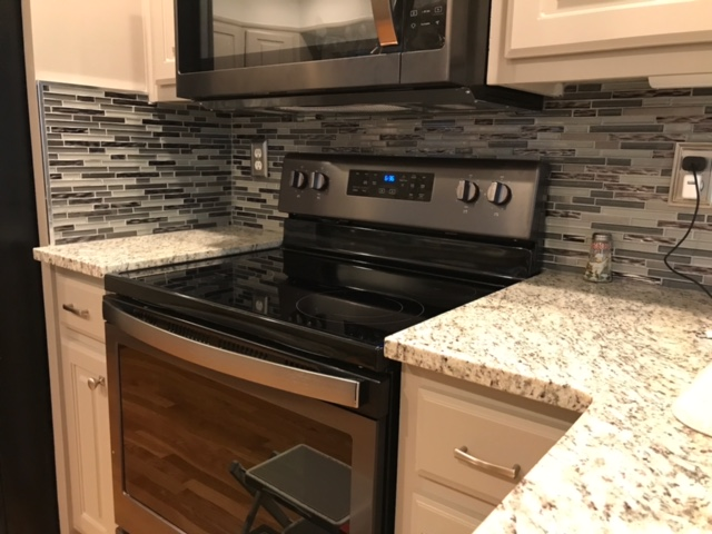 Modern Kitchen with new oven and granite countertops