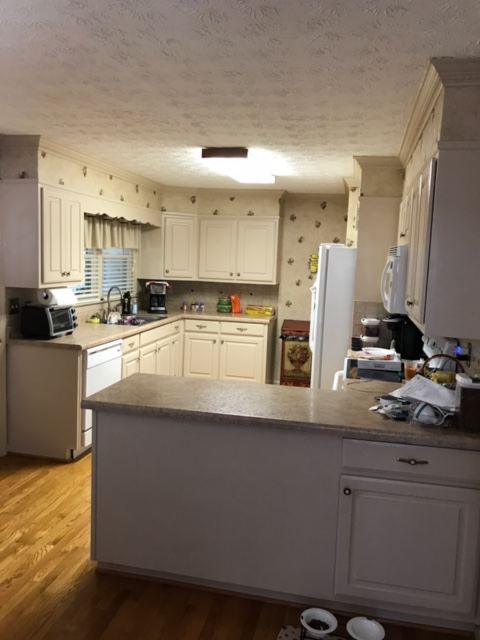 Dated Kitchen with formica countertops and wallpaper