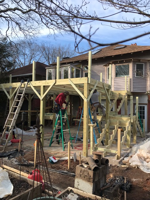 back wooden deck and stairs being constructed in backyard