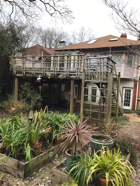 back of home with old deck in disrepair