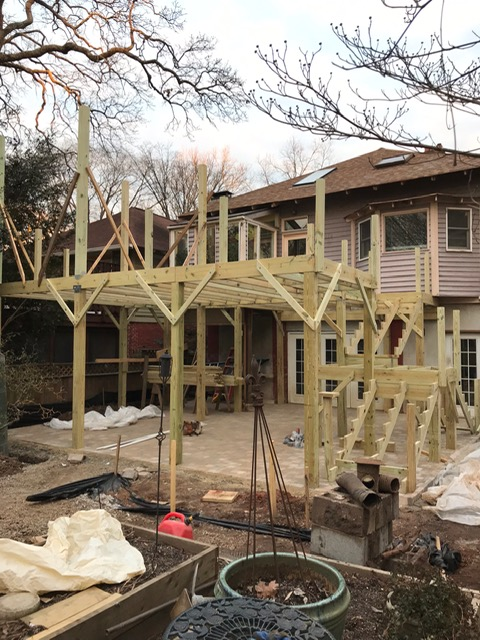 back of home with new wooden deck and screened porch being constructed