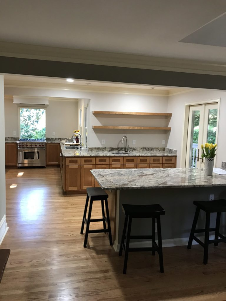 modern kitchen with stone countertop and wood cabinets