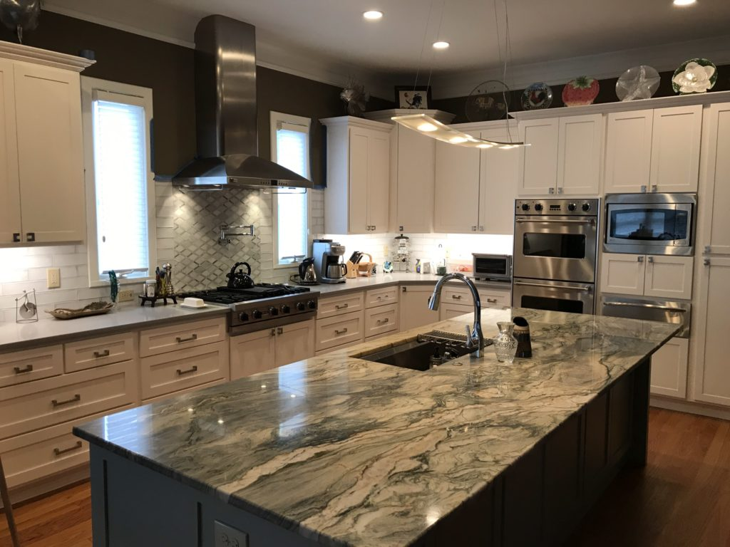 modern kitchen with granite countertops and stainless steel appliances