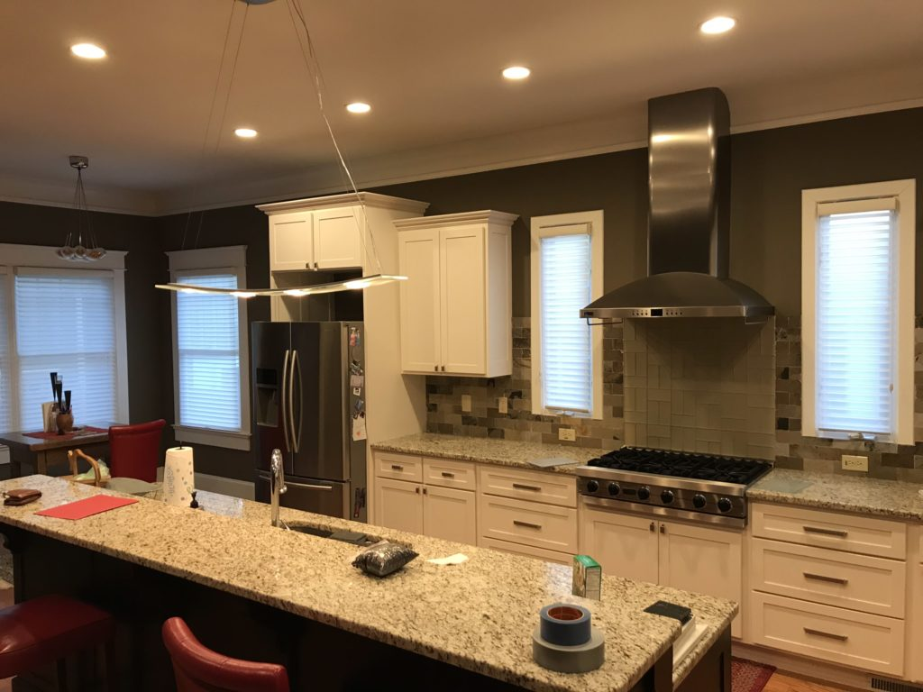 kitchen with granite countertop and 2-tier barstool seating at island