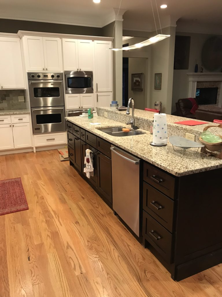 kitchen with granite countertop and 2-tier barstool seating